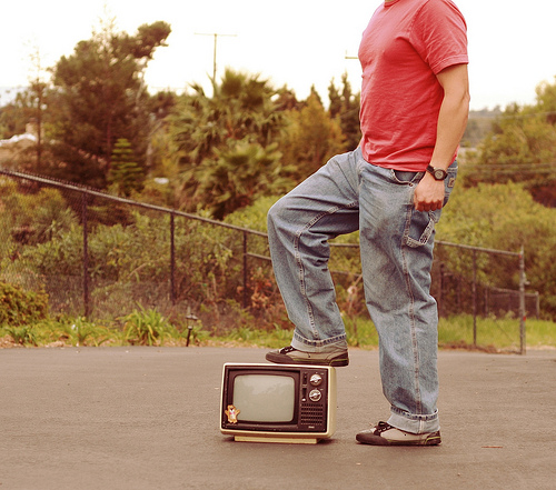 Man steps on old TV