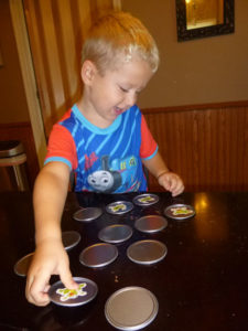 Playing the juice can lid memory game