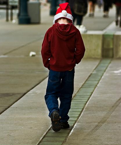Sad boy in a Santa hat