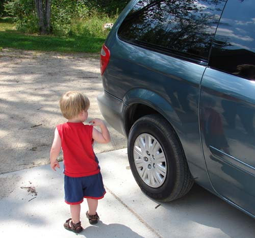 Boy and minivan