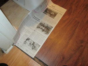 Using newspaper for templates for the DIY bathroom floor install