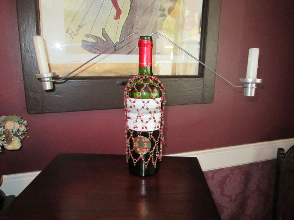 Make a wine bottle candelabra